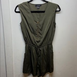 Olive green sleeve less romper has pockets!